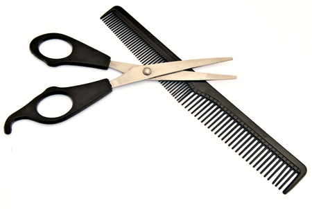 comb: Scissors over comb haircut, surrounded by white background Stock Photo