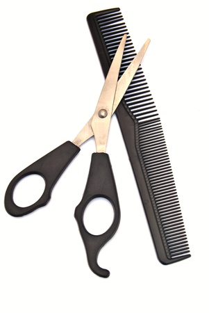 comb: Scissors for cutting hair on a comb, surrounded by white background