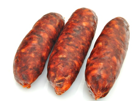 next to each other: Sausages stacked next to each other, surrounded by white background