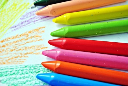 Colored pencils alongside each other on wallpaper Stock Photo - 11469022
