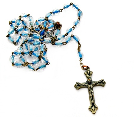 rosary: Cordon blue coils, a crucifix at the end all surrounded by white background Stock Photo
