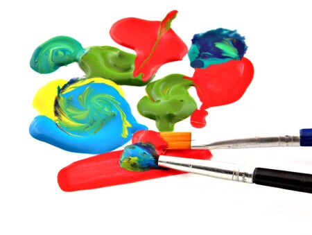 Acrylic paints in various colors side by side with a brush, surrounded by white background Stock Photo - 11999018