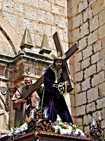 Jesus carrying the cross during a procession of Holy Week in Spain Stock Photo - 12013554