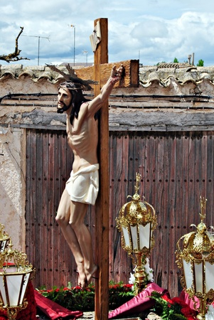 Jesus Christ on the cross during a procession of Holy Week in Spain photo