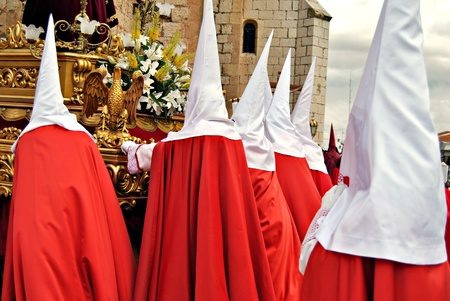 procession: Group Nazarenes with their hoods during a Holy Week procession in Spain Stock Photo