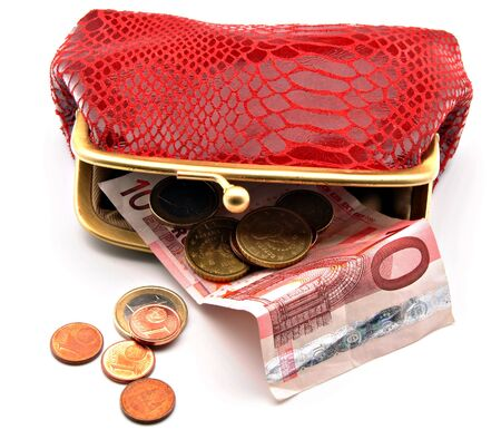 Red open purse with euro coins and notes Фото со стока