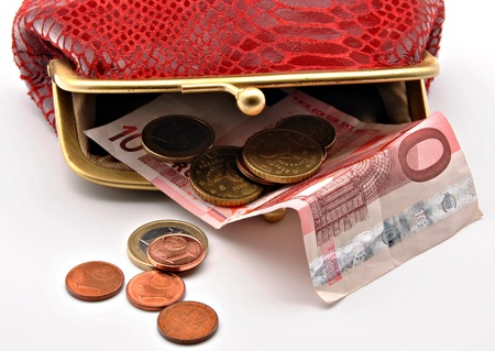 Red open purse with euro coins and notes photo