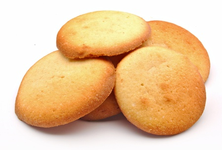 Several cookies stacked next to each other surrounded by white background