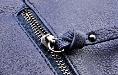 half open: Half open zipper plastic background navy blue Stock Photo