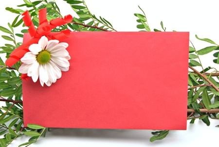Red card decorated with a daisysurrounded by leafy branches photo