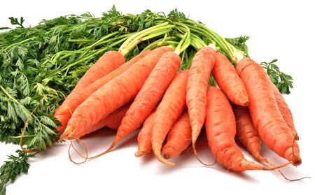 Carrots stacked next to each other in clusters, surrounded by white background photo
