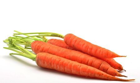 next to each other: Carrots stacked next to each other, surrounded by white background Stock Photo