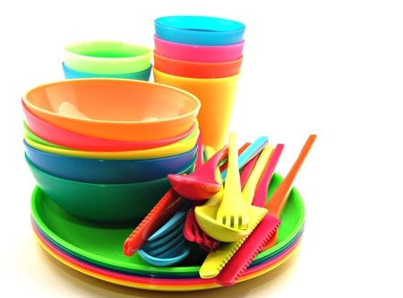 plastic: Plastic tableware consisting of cutlery, plates and bowls Stock Photo