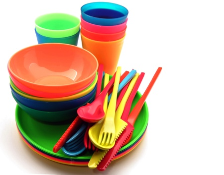 disposable: Plastic tableware consisting of cutlery, plates and bowls Stock Photo