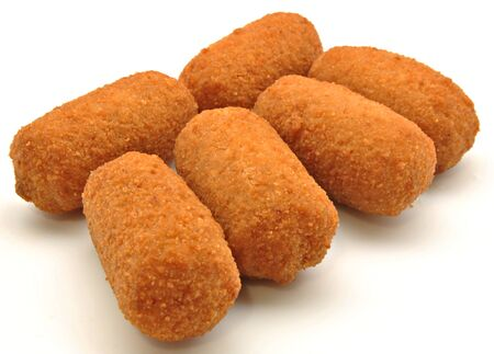 croquettes: Croquettes next to each other surrounded by white background