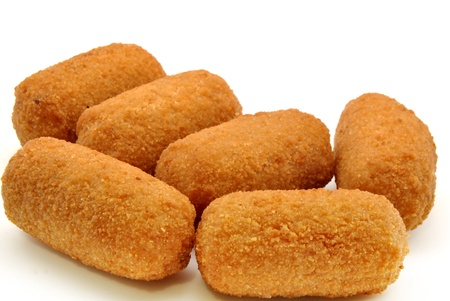 Croquettes next to each other surrounded by white background