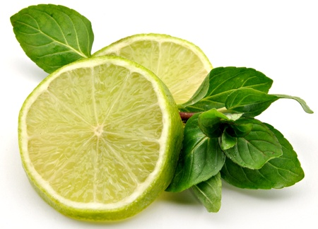 Lime wedges with mint leaves, surrounded by white background Stock Photo - 12345699