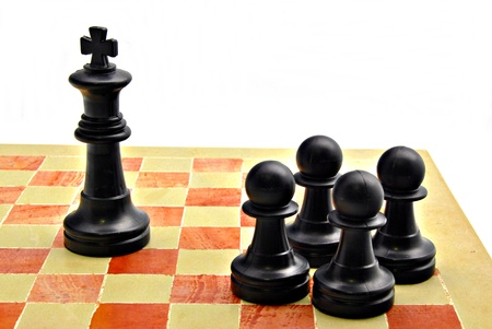 Four pawns black color with the king of the same color Stock Photo - 12536079
