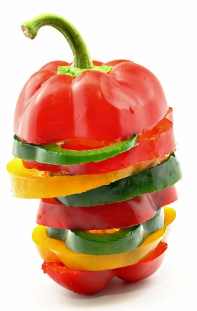 bell pepper: Pepper slices of different colors one on top of another surrounded by white background