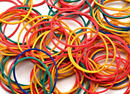 incommunicado: Colored rubber bands next to each other forming a background