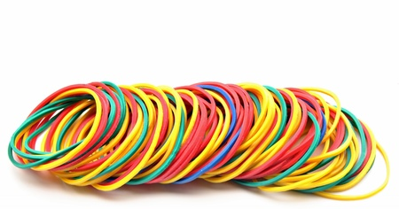 incommunicado: Colored rubber bands next to each other surrounded by white background