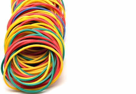 Colored rubber bands next to each other surrounded by white background Stock Photo - 12536042