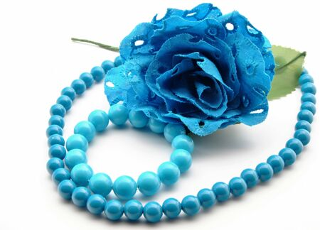 Flower and blue bracelet, surrounded by white background Stock Photo