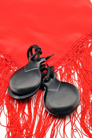 Ornaments made flamenco castanets on colored fabrics photo
