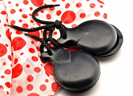 typical: Ornaments made flamenco castanets on colored fabrics