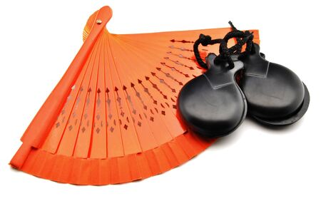 Ornaments made  by fans of flamenco and castanets surrounded by white background Stock Photo