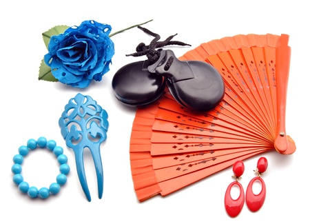 Flamenco ornaments consisting of fans, castanets, bracelets and a blue flower surrounded by white background Stock Photo