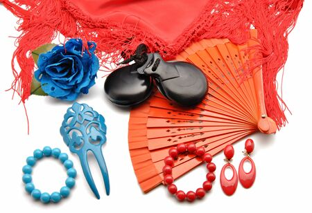 Flamenco ornaments consisting of fans, castanets, bracelets and a blue flower surrounded by white background photo