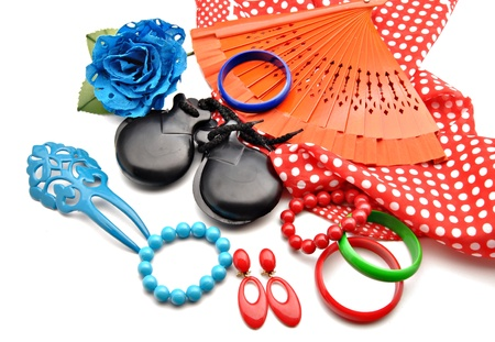 Flamenco ornaments consisting of fans, castanets, bracelets surrounded by white background