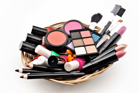 esthetician: Make objects stacked alongside others in a wicker basket surrounded by white background Stock Photo
