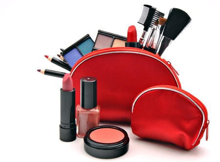 cosmetic products: Several useful makeup within a red suitcase and other outside
