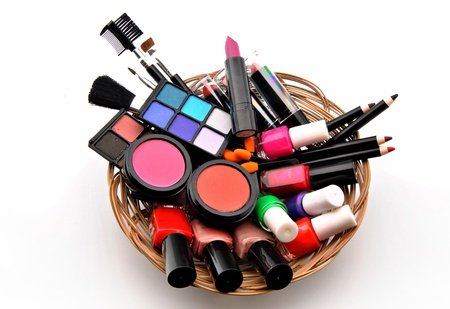 esthetician: Several useful makeup stacked next to each other in a wicker basket Stock Photo