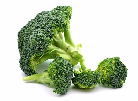 Several broccoli next to each other surrounded by white background