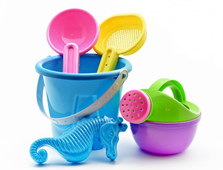 sand mold: Some beach toys surrounded by white background