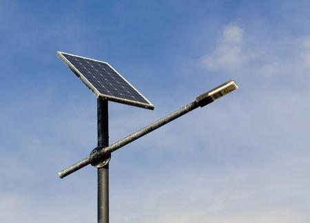 solar cell: Solar panels to power a light bulb on blue sky