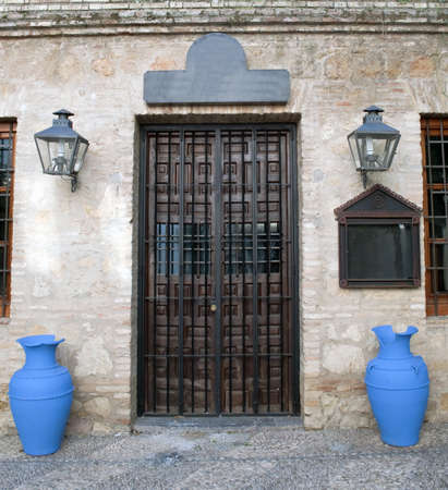 Entrance door with two vessels blue besides
