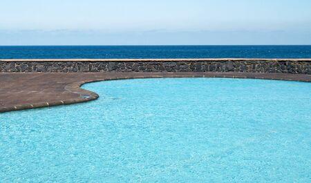 Swimming pool beside the sea in the Spanish town of Tabaiba in Tenerife Stock Photo