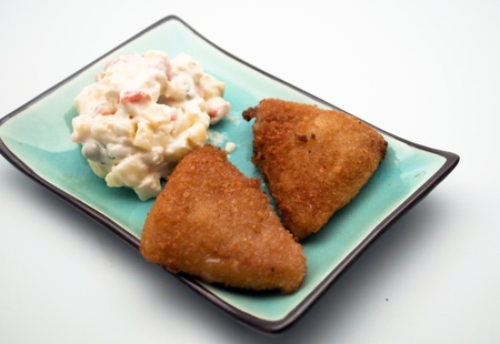 russian salad: Two chicken fillets with russian salad Stock Photo