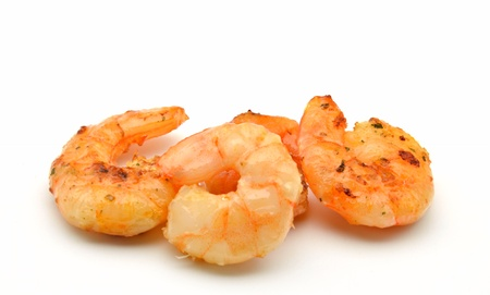 Several peeled shrimp surrounded by white background