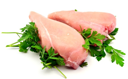 Chicken breasts with parsley surrounded by white background