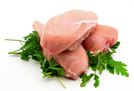 chicken breast: Chicken breasts with parsley surrounded by white background