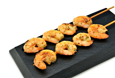 carabineer: Skewer shrimp on black plate