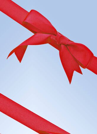 Vertical red ribbon surrounded by blue background photo