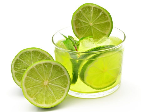Mojito decorated with limes and ice photo