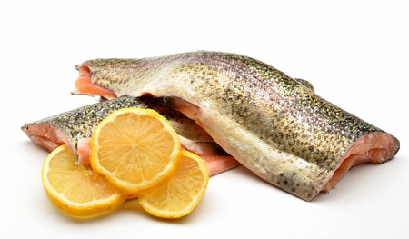 Trout fillets with several slices of lemon surrounded by white background Stock Photo - 13523995