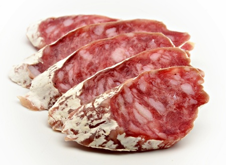 longaniza: Several slices of Salchichon next to each other surrounded by white background